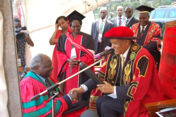 President Kibaki receives honorary doctorate from Prof. Mondo Kagonyera