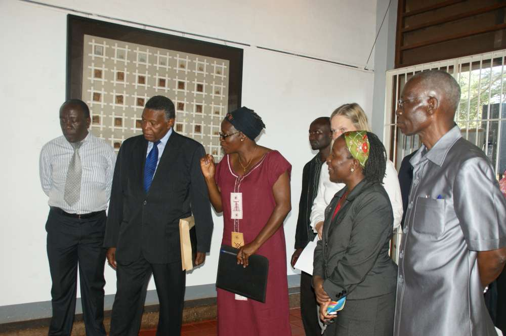 Dr. Kirumira explains an art work to the High Commissioner